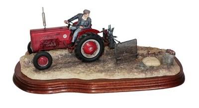 Lot 16 - *  Border Fine Arts 'Lifting The Pinks' (International B250 Tractor), model No. B0219 by Ray Ayres