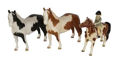 Lot 96 - ~Beswick Girl on Pony, model No. 1499; together with Pinto Pony, model No. 1372, Piebald matt...