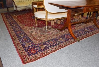 Lot 1087 - Oriental Carpet probably Tabriz, the field of scrolling vines around a medallion framed by...