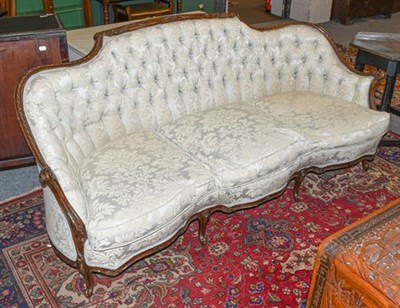 Lot 1093 - A George III style mahogany framed sofa, late 19th century, recovered in green buttoned fabric,...