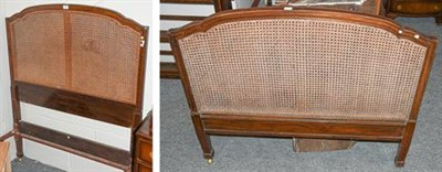 Lot 1105 - A pair of Heal & Son Ltd, London bed frames, with mahogany and canework head and foot boards,...