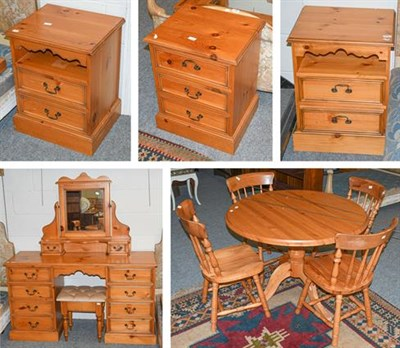 Lot 1108 - A quantity of modern pine furniture comprising a pedestal dining table and four chairs, a...
