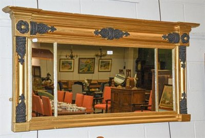 Lot 1110 - A Regency sectional break-front over-mantle mirror with black painted embellishment on a gilt...