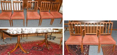 Lot 1112 - A reproduction yew wood dining room suite comprising a twin pedestal extending dining table,...