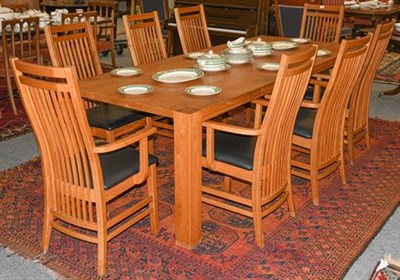 Lot 1113 - A modern oak plank-top dining table, with square supports, together with a set of eight...