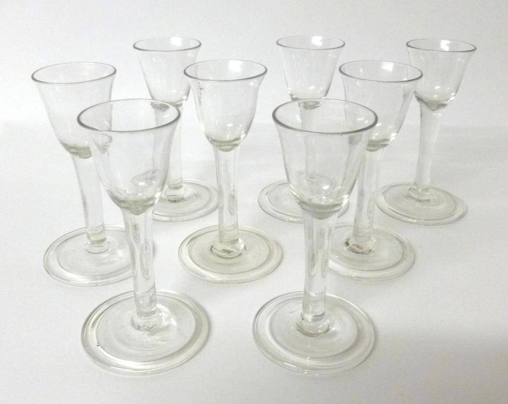 Lot 8 - A Set of Eight Cordial Glasses, mid 18th century, the bell shaped bowls on plain stems and...