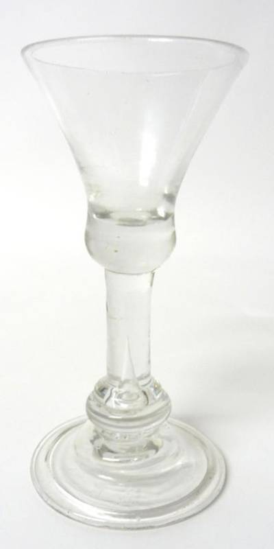 Lot 12 - A Wine Glass, circa 1720, the waisted bell bowl with solid base on a plain stem with annulated...