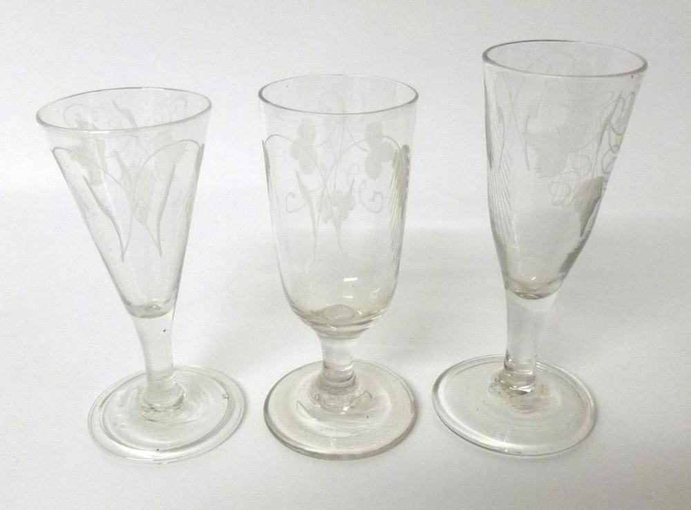 Lot 15 - An Ale Glass, circa 1800, the drawn trumpet bowl engraved with hops and barley on a plain stem...