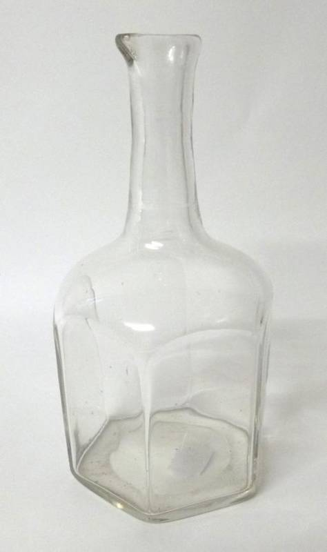 Lot 27 - A Glass Mallet Decanter, in George II style, the cylindrical neck with pouring spout over an...