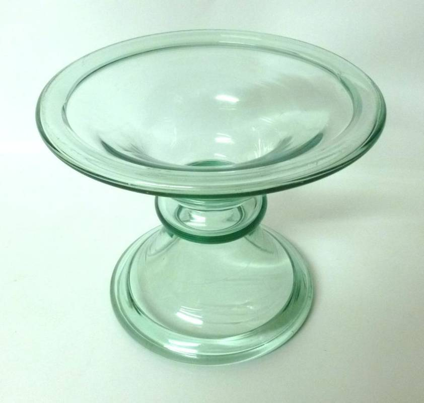 Lot 37 - A Green Tinted Glass Ham Stand, 19th century, of hollow bobbin form with folded rims, 19.5cm high